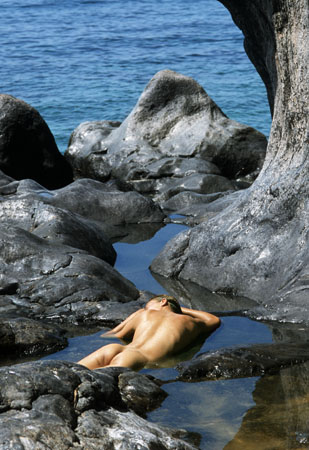Nude lying on rocks